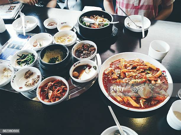 high angle view of korean food served on restaurant table - korean food stock pictures, royalty-free photos & images