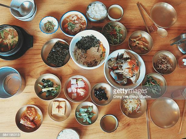High Angle View Of Korean Food Served On Table