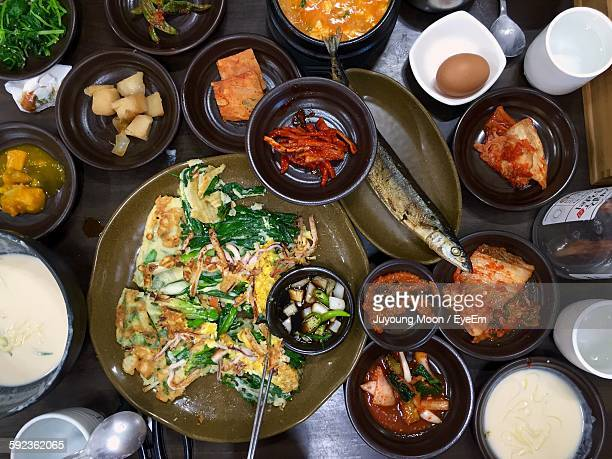 high angle view of korean food served on table - korean food stock pictures, royalty-free photos & images