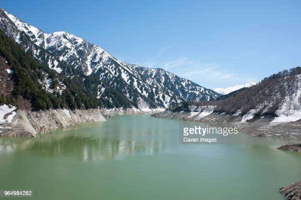 High angle view of Kurobe River by mountains against sky