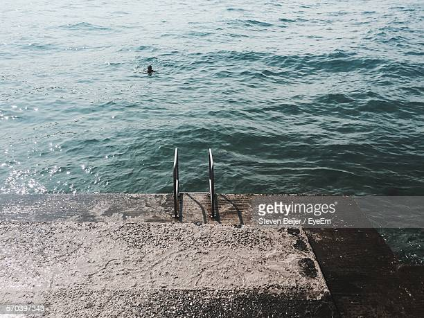 High Angle View Of Ladder On Pier By Sea