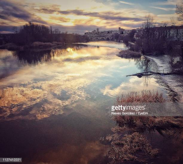high angle view of lake against sky at sunset - zamora stock pictures, royalty-free photos & images