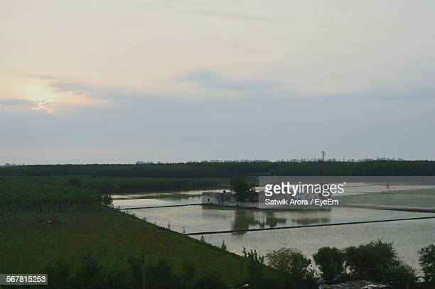 high angle view of lake along countryside landscape - punjab india stock pictures, royalty-free photos & images