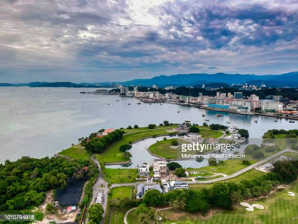 high angle view of lake and cityscape against sky - kota kinabalu stock pictures, royalty-free photos & images