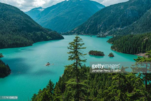 high angle view of lake and mountains - diablo lake stock photos and pictures