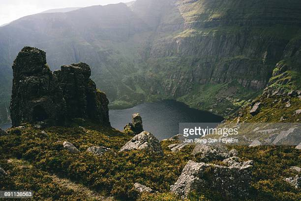 high angle view of lake by rocky mountains - county waterford ireland stock pictures, royalty-free photos & images