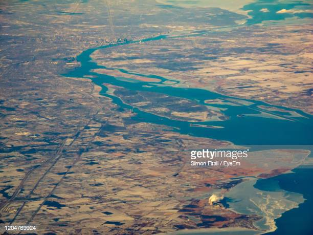 high angle view of lake in city - detroit river stock pictures, royalty-free photos & images