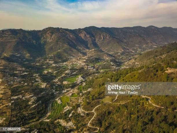 high angle view of land and mountains against sky - イスラマバード ストックフォトと画像