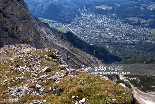 high angle view of land and mountains - mittenwald stock pictures, royalty-free photos & images