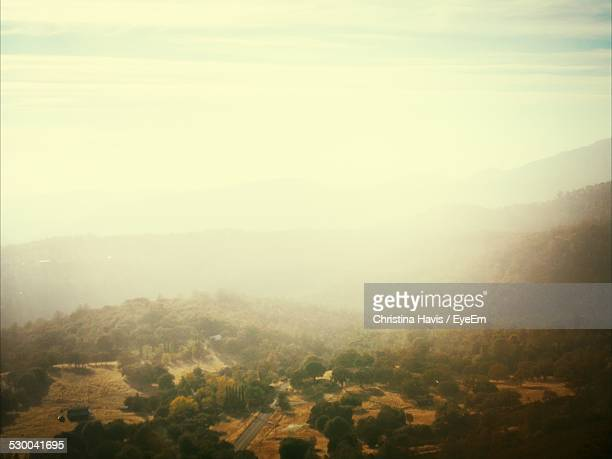High Angle View Of Landscape Against Sky In Foggy Weather