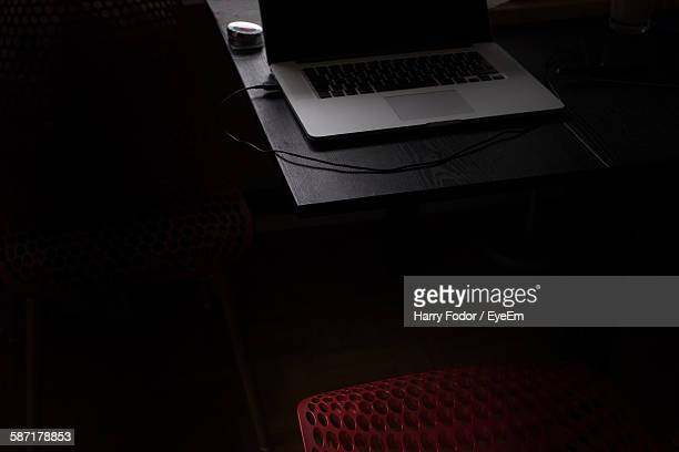 High Angle View Of Laptop And Chair In Darkroom