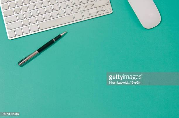 high angle view of laptop keyboard by pencil - viewpoint stock pictures, royalty-free photos & images