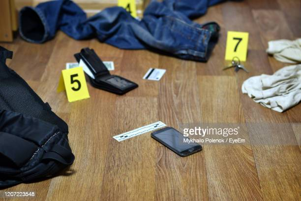 high angle view of laptop on table - crime scene stock pictures, royalty-free photos & images