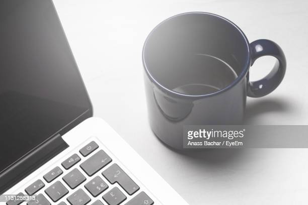High Angle View Of Laptop With Black Coffee On Table