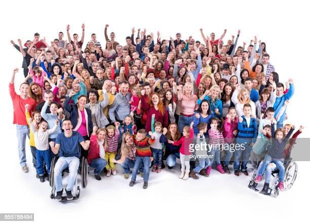 High angle view of large group of cheerful people with raised arms.