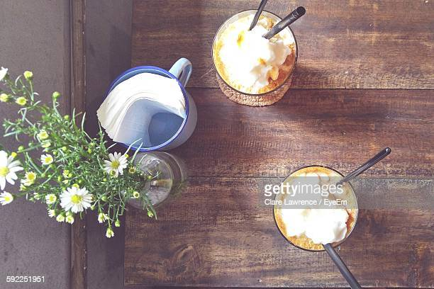 High Angle View Of Latte Smoothie With Whipped Cream