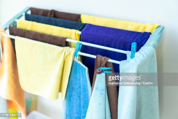high angle view of laundry drying against wall - drying stock pictures, royalty-free photos & images