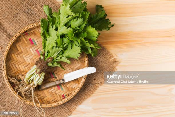 High Angle View Of Leaf Vegetables In Basket On Table