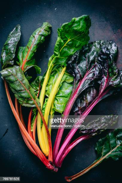 high angle view of leafy vegetables on table - leaf vegetable stock pictures, royalty-free photos & images