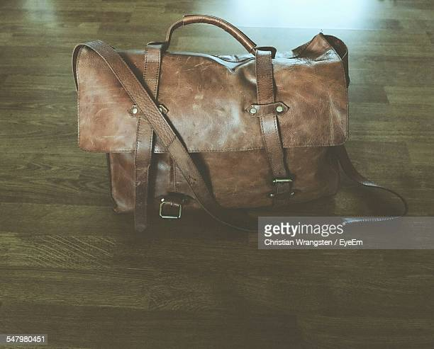 High Angle View Of Leather Bag On Floor At Home