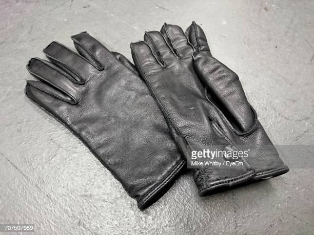 High Angle View Of Leather Gloves On Floor