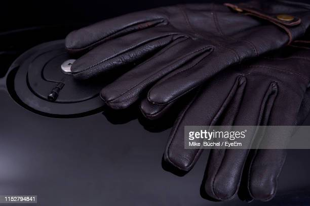 high angle view of leather gloves on motorcycle - leather glove stock pictures, royalty-free photos & images