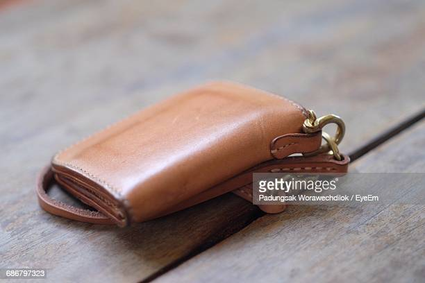 high angle view of leather purse on wooden table - leather purse stock pictures, royalty-free photos & images