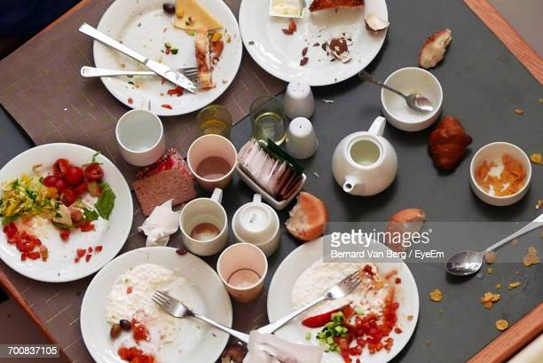 High Angle View Of Leftovers On Table At Restaurant