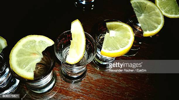 High Angle View Of Lemon Slices On Tequila Glasses At Restaurant