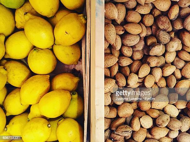 High Angle View Of Lemons And Almonds At Market