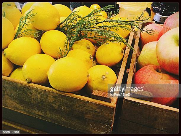 High Angle View Of Lemons And Apples In Wooden Crates