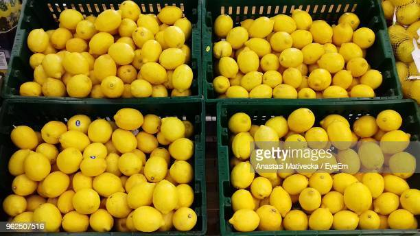 high angle view of lemons in market - anastasi foto e immagini stock