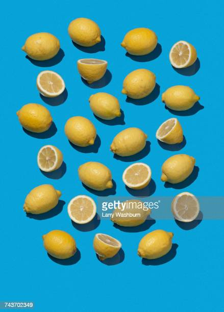 High angle view of lemons on blue background