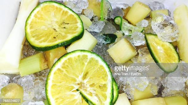 high angle view of lemons on crushed ice - crushed ice stock pictures, royalty-free photos & images
