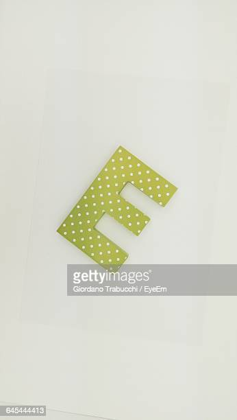 High Angle View Of Letter E On White Background