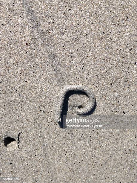 High Angle View Of Letter P On Sand