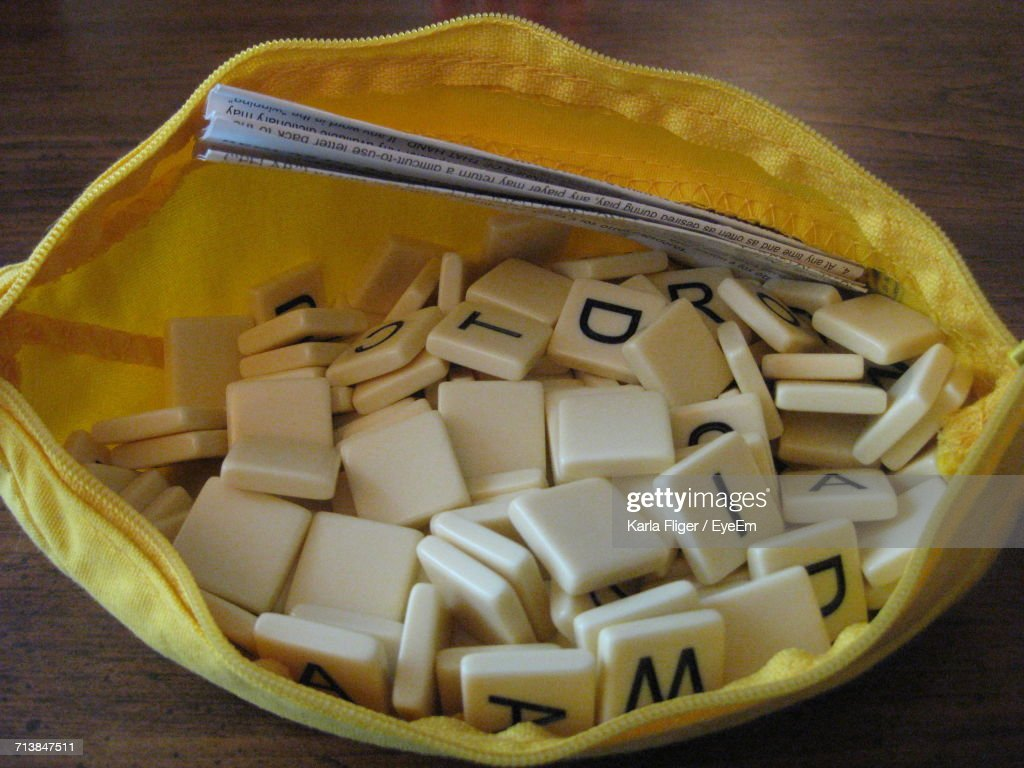 High Angle View Of Letter Tiles With Instruction In Pouch : Stock Photo