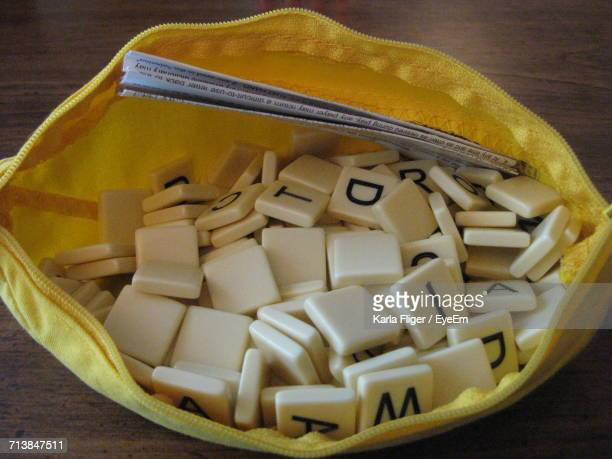 High Angle View Of Letter Tiles With Instruction In Pouch