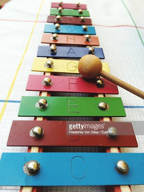 high angle view of letters on colorful glockenspiel - glockenspiel stock photos and pictures
