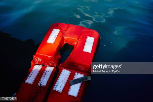 High Angle View Of Life Jacket Floating On Sea