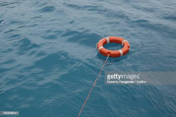 High Angle View Of Life Ring Floating On Sea