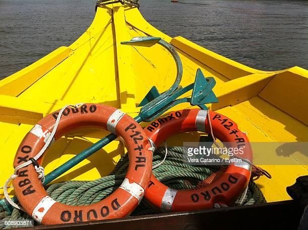 High Angle View Of Lifebelts And Anchor In Boat On River