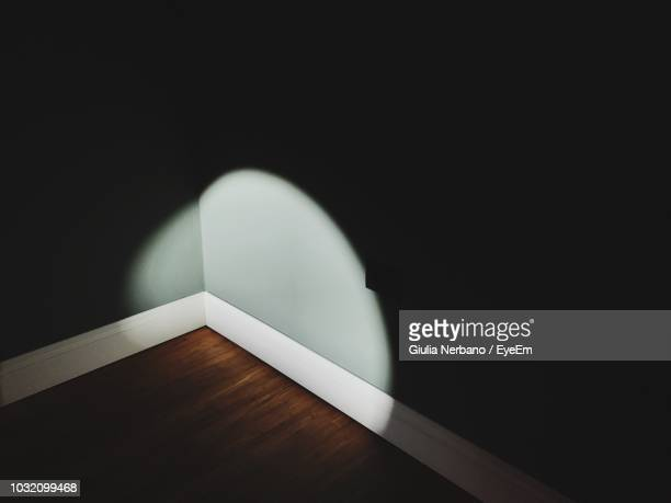 high angle view of light falling in corner of room - corner stock pictures, royalty-free photos & images