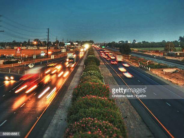 high angle view of light trails on country road at dusk - マーセド郡 ストックフォトと画像