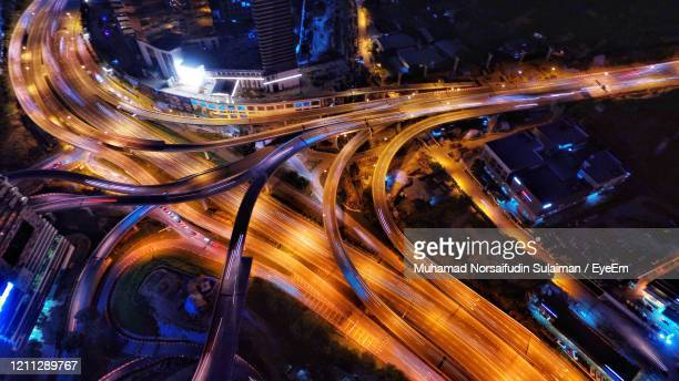 high angle view of light trails on elevated road - motorway stock pictures, royalty-free photos & images