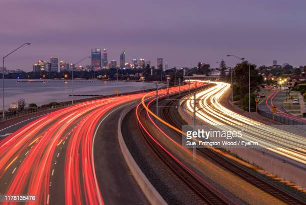 high angle view of light trails on highway at night - perth australia stock pictures, royalty-free photos & images