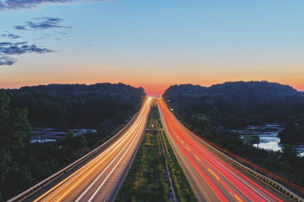 High angle view of light trails on highway at sunset,Oakwood,Illinois,United States,USA
