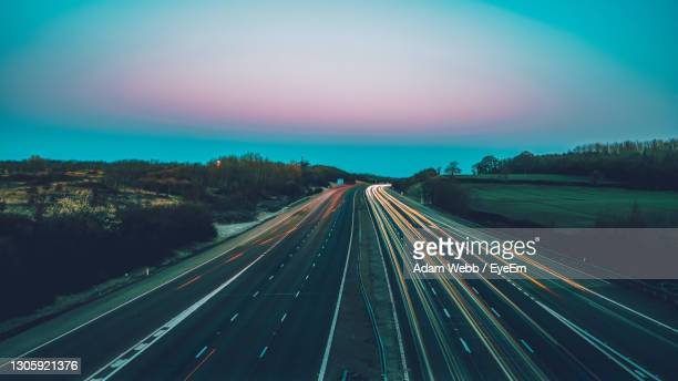 high angle view of light trails on highway - dark stock pictures, royalty-free photos & images