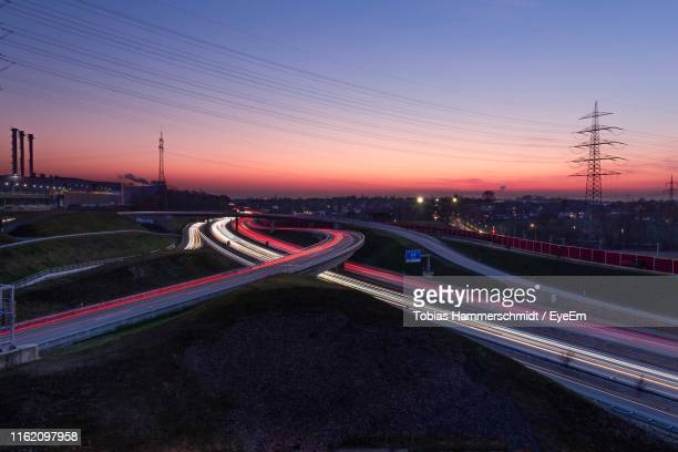 high angle view of light trails on road against sky during sunset - north rhine westphalia stock pictures, royalty-free photos & images