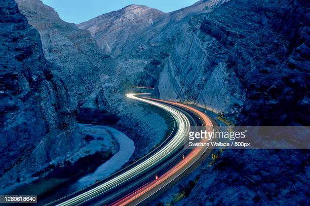 high angle view of light trails on road against sky - long exposure stock pictures, royalty-free photos & images